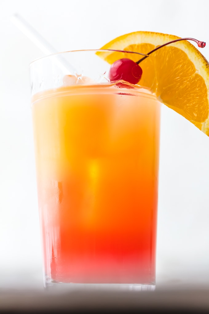 This TEQUILA SUNRISE is tailor made for tailgating! This Tequila Sunrise Cake is made with Orange Juice, Grenadine, Tequila, and Beer, this fun cocktail is loved by all and an awesome way to start the day cheering for your favorite team. The ultimate brunch or game day cocktail!