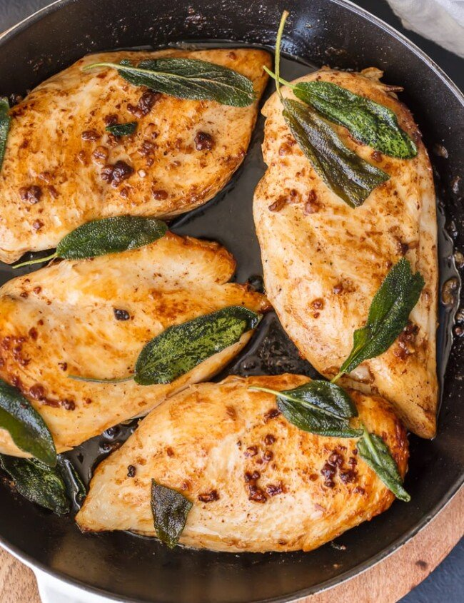This BRINE CHICKEN BREAST with Garlic and CRISPY SAGE is one of our favorite easy meals for entertaining guests or a delicious night at home. You won't believe how tasty these simple garlic and sage chicken flavors are until you try them all together. The garlic brine makes the chicken SO TENDER and JUICY!