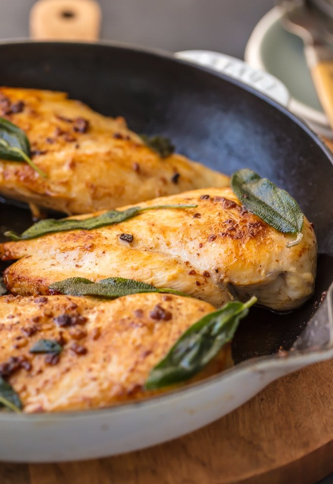 Brine Chicken Breast with crispy sage leaves in pan