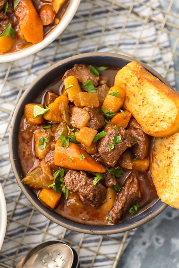 bowl of beef stew with toasted bread