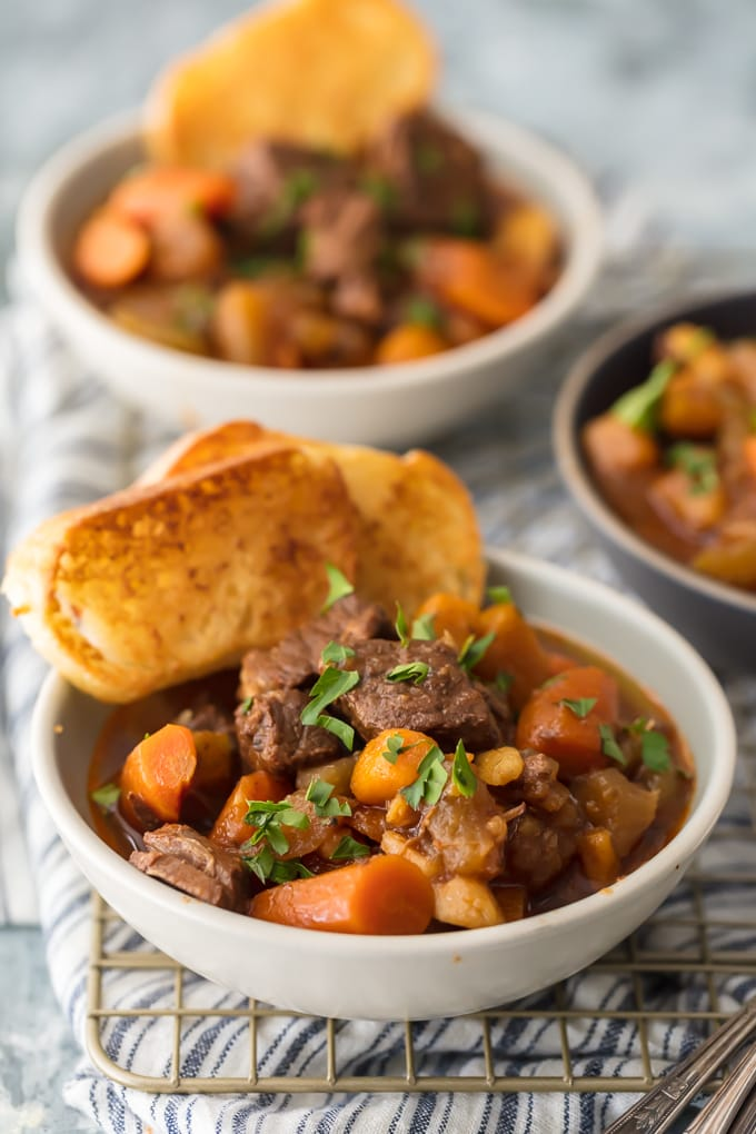 bowls of stew with toasted bread