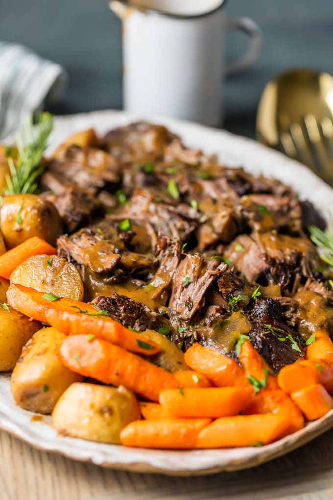 instant pot pot roast with carrots and potatoes on platter