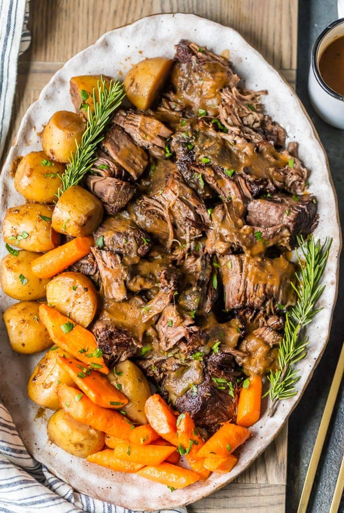 instant pot pot roast with potatoes and carrots on a platter