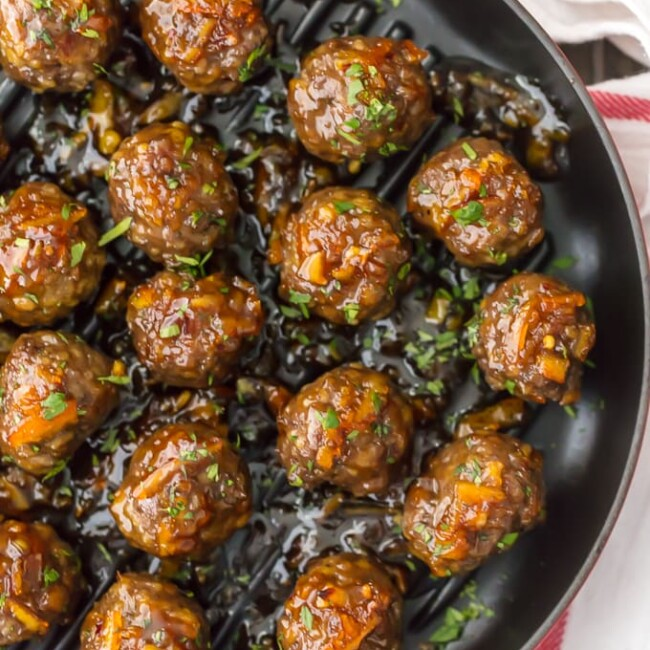 These ORANGE MARMALADE MEATBALLS are one of our favorite quick and fool-proof game day recipes. I LOVE the bright orange flavor and mix of savory and sweet. These meatballs are gone in seconds each and every time we make them. Serve this meatball recipe as an appetizer on their own or as a meal over rice!
