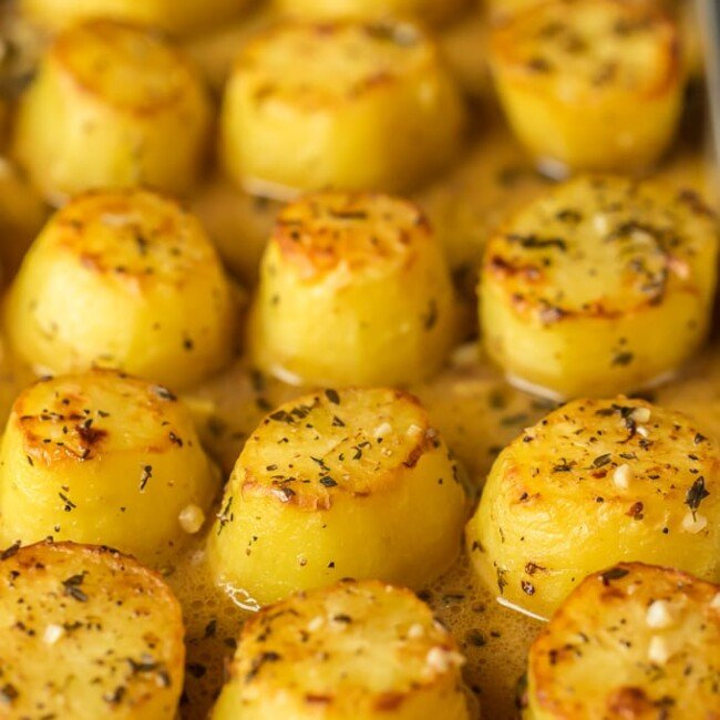 These OVEN ROASTED MELTING POTATOES are the ultimate side dish. Practically dripping butter, these soft and tender OVEN ROASTED POTATOES go with any and every meal and are sure to please. These are my very favorite potato side dish! It doesn't get better than this!
