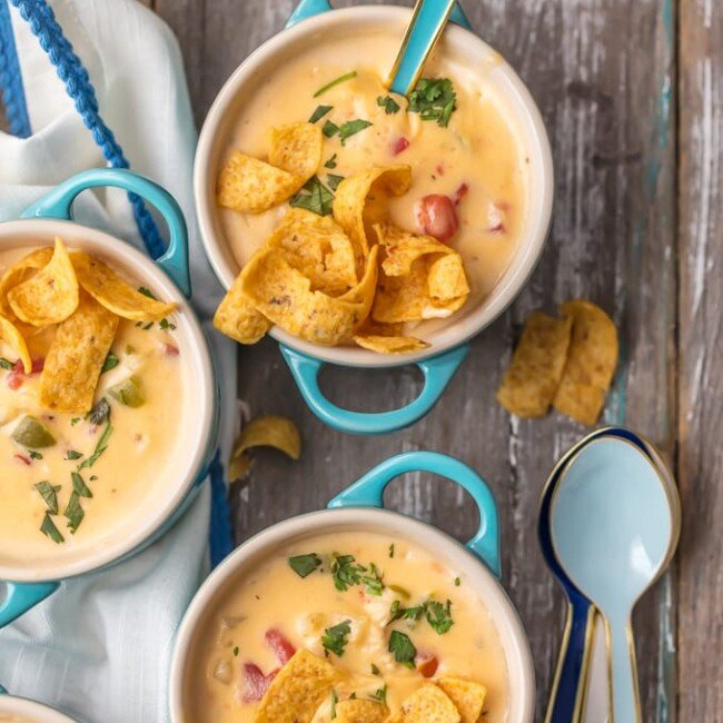 This MEXICAN CHEESY CHICKEN CHOWDER RECIPE is the ultimate Winter comfort food soup! Loaded with spicy tomatoes, green peppers, hash brown potatoes, garlic, onion, CHEESE, and more, this was an instant favorite at our house. Serve this cheesy chicken chowder with Fritos or tortilla chips and you're in business. SO GOOD.
