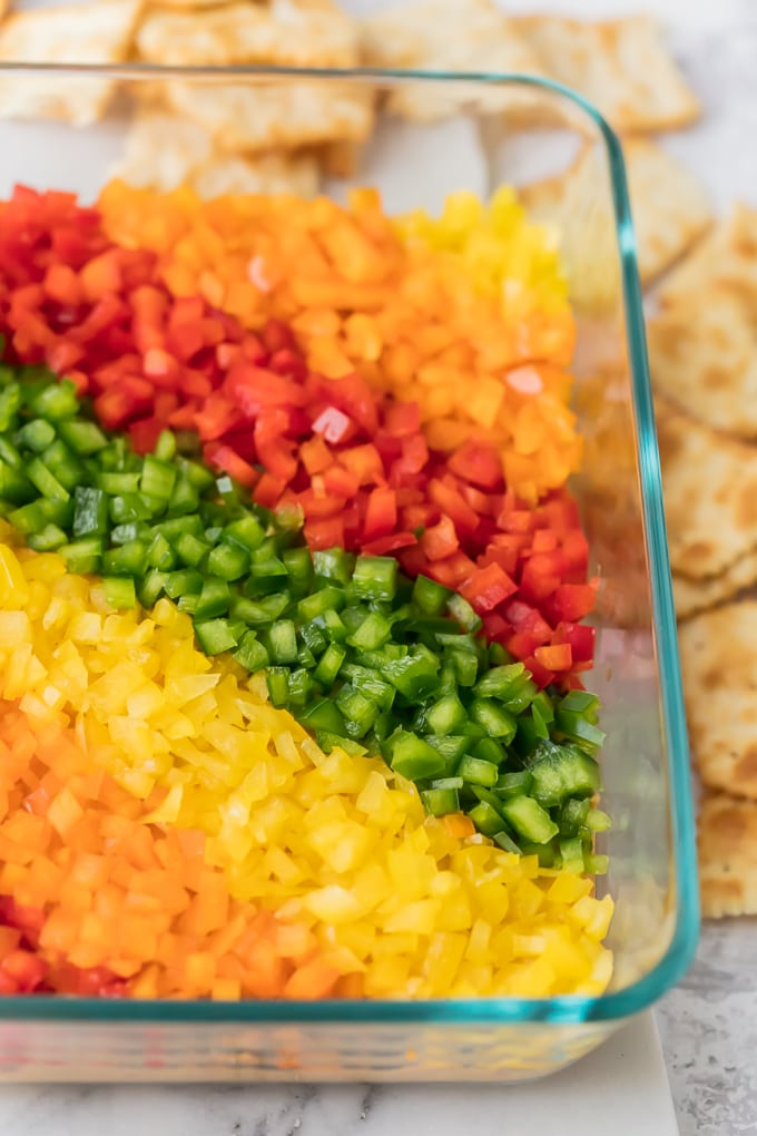 close up view of rainbow pepper hummus dip