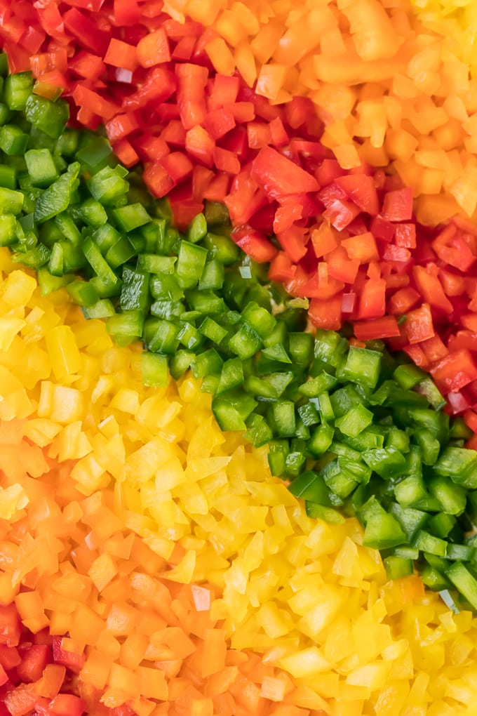 close up view of diced peppers placed in a rainbow fashion
