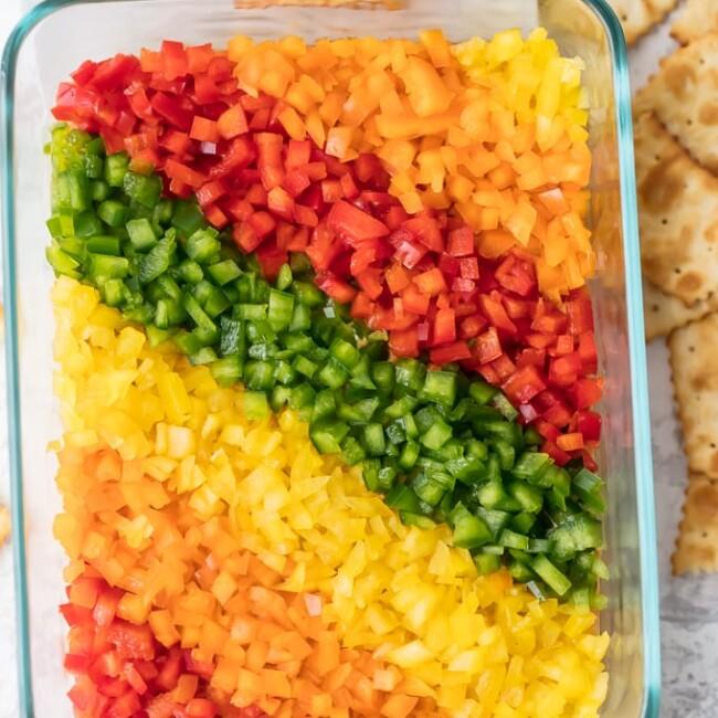 rainbow pepper hummus dip in a glass dish