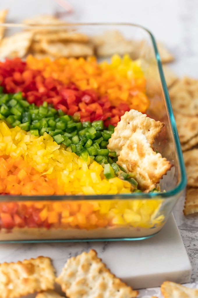 crackers in a rainbow hummus dip