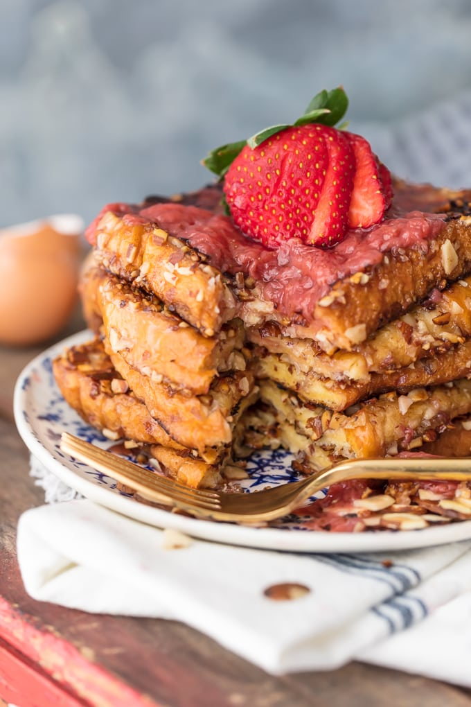 A stack of french toast with a bite taken out of it