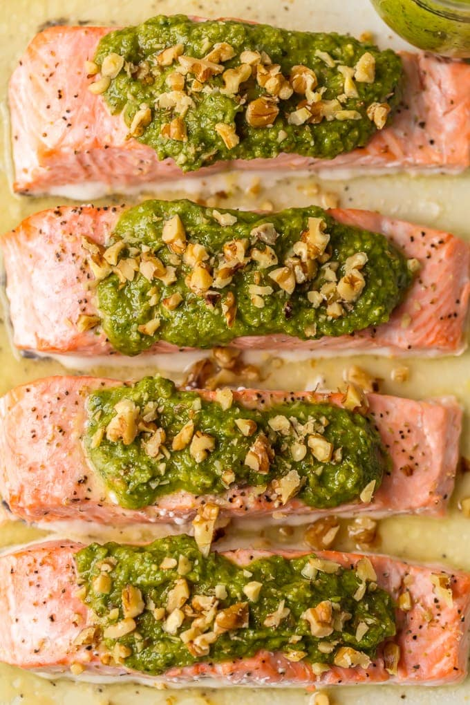 salmon fillets topped with pesto and walnuts