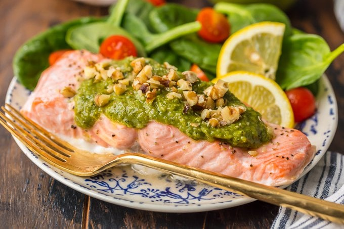 baked pesto salmon and salad on a plate
