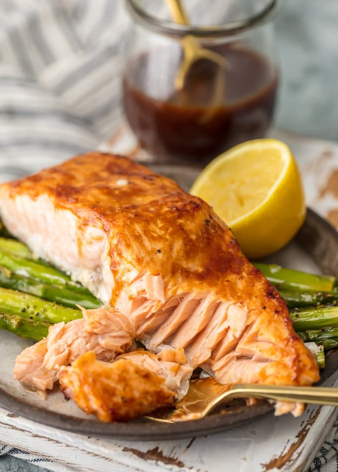 This HOISIN SALMON AND ASPARAGUS RECIPE has it all! It's a simple and healthy seafood recipe made entirely on ONE SHEET PAN. So much flavor and so little prep/cleanup. So much to love about this sheet pan glazed salmon.