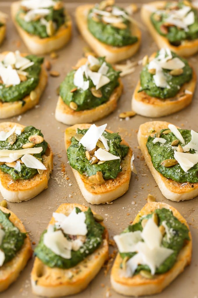 spinach dip crostinis arranged on a surface