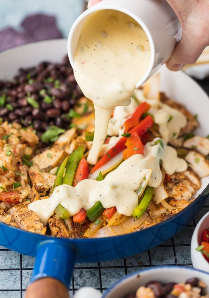 Chicken Fajitas smothered in queso