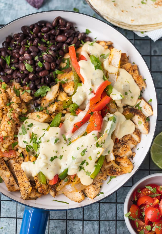 beans, peppers, and chicken in a skillet