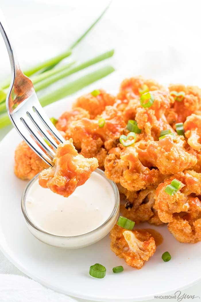 Baked Healthy Buffalo Cauliflower Bites | Wholesome Yum