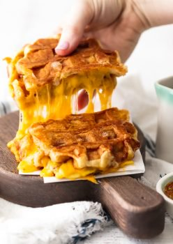 Waffle Sandwich? Yes! This fun and easy Apple Cheddar Waffle Grilled Cheese recipe is so delicious and only has 5 ingredients! The simple flavors of the maple dijon sauce blend perfectly with the creamy cheddar, crisp apples, and sweet waffles.