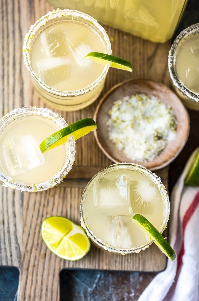 overhead shot of margaritas with limes and salt