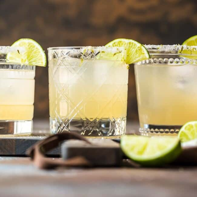margaritas in glasses with lime garnish