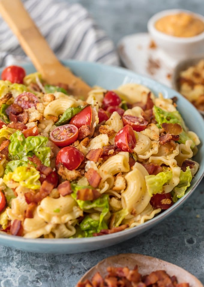 This BLT Pasta Salad Recipe is loaded with juicy tomatoes, crispy bacon, fresh lettuce, and tiny toasted croutons. BLT Pasta Salad is tossed in a flavored mayonnaise dressing and is the ultimate Summer Pasta Salad Recipe! BBQs, parties, and holiday celebrations like the 4th of July NEED this amazing side dish.