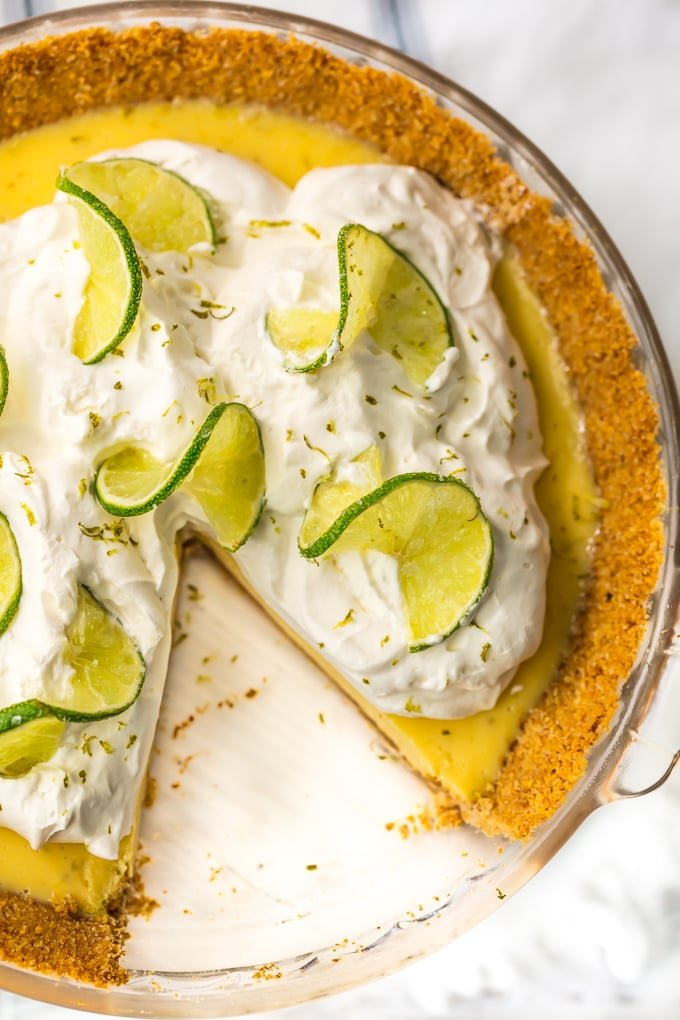 over the top view of a key lime pie with a slice cut out
