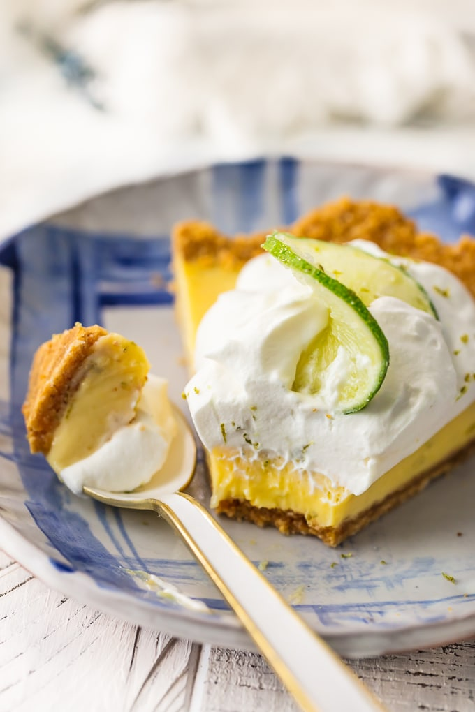 piece of key lime pie on plate with spoonful of pie