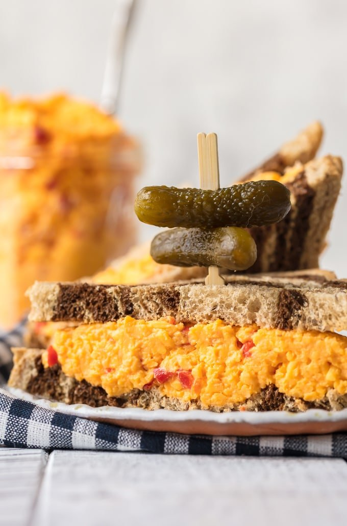 Pimento Cheeses Sandwich with bite-sized pickles on top