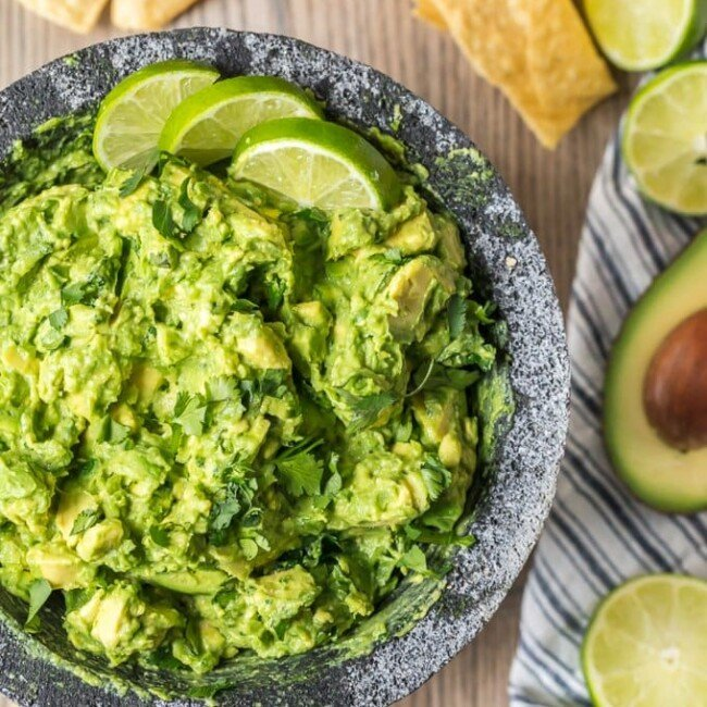 The BEST GUACAMOLE RECIPE EVER! I'm a big fan of Mexican food and dips. So of course I'm obsessed with guacamole too. I cut this Simple Guacamole Recipe down to the basics and it is so fresh. Everything blends together to create the perfect, creamy flavor. This Homemade Guacamole Recipe is my favorite dip for Mexican dinners. I could eat it alll day!