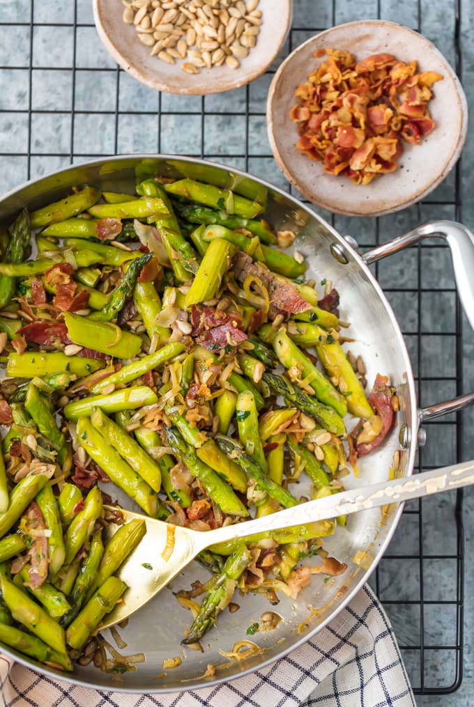 A mixture of asparagus, leeks, Pancetta, garlic, in a skillet