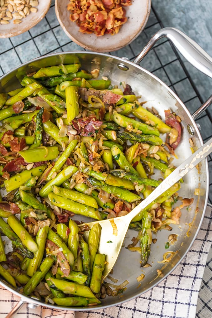 A pan filled with chopped asparagus and sliced pancetta