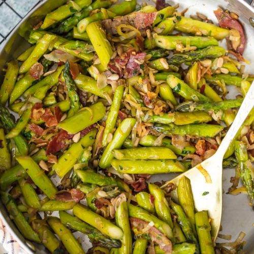 SAUTEED ASPARAGUS is the perfect side dish for any meal, and the Pancetta makes it even better! The leeks, garlic, and pine nuts add so much flavor to this dish...it just might be the Best Asparagus Recipe I've ever had. This Sauteed Asparagus Recipe with Pancetta is good enough to eat on its own, but it pairs well with other pork recipes.