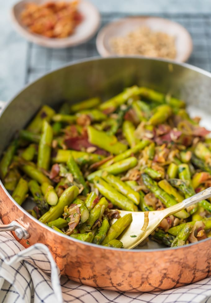 Bright green asparagus cooking in a skillet