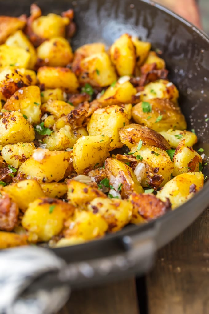 Golden fried potatoes in a large black skillet