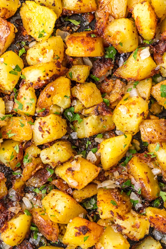 Close up of golden home fries with onion and thyme