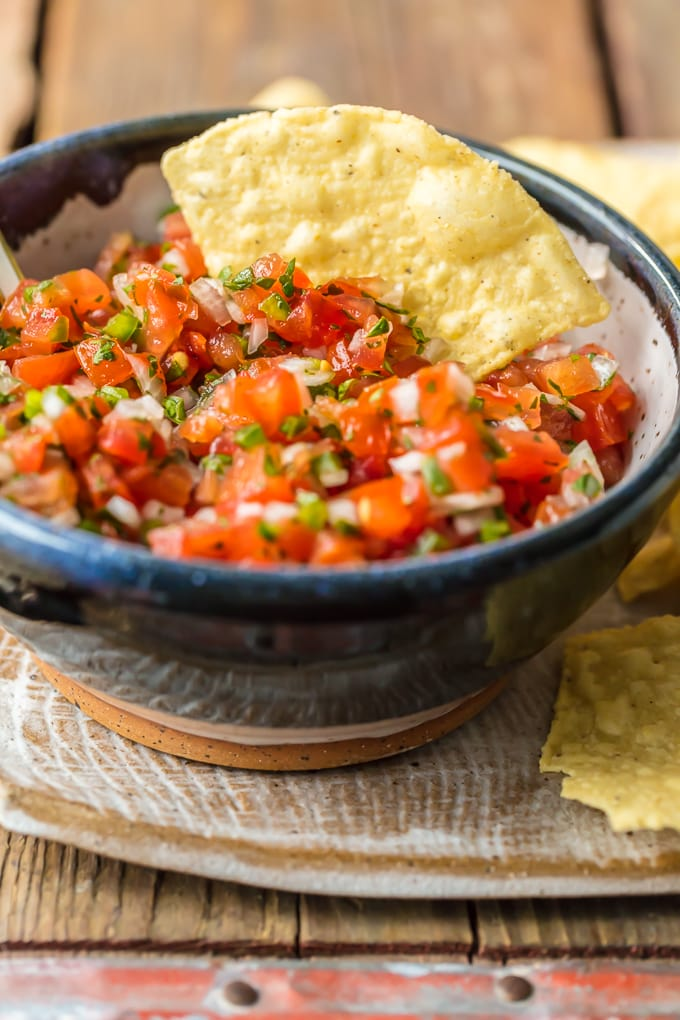 chip in bowl of pico de gallo