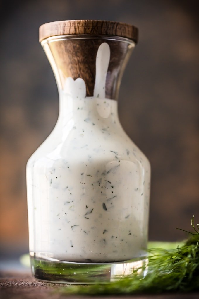 Glass jar filled with a homemade ranch dressing recipe