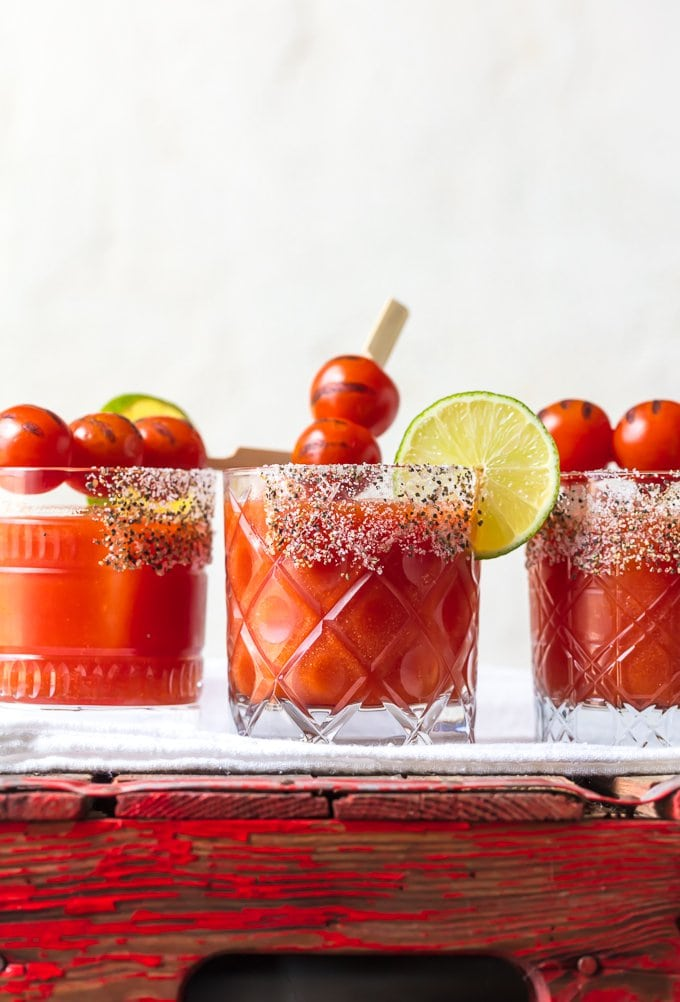 3 tomato margaritas garnished with roasted cherry tomatoes