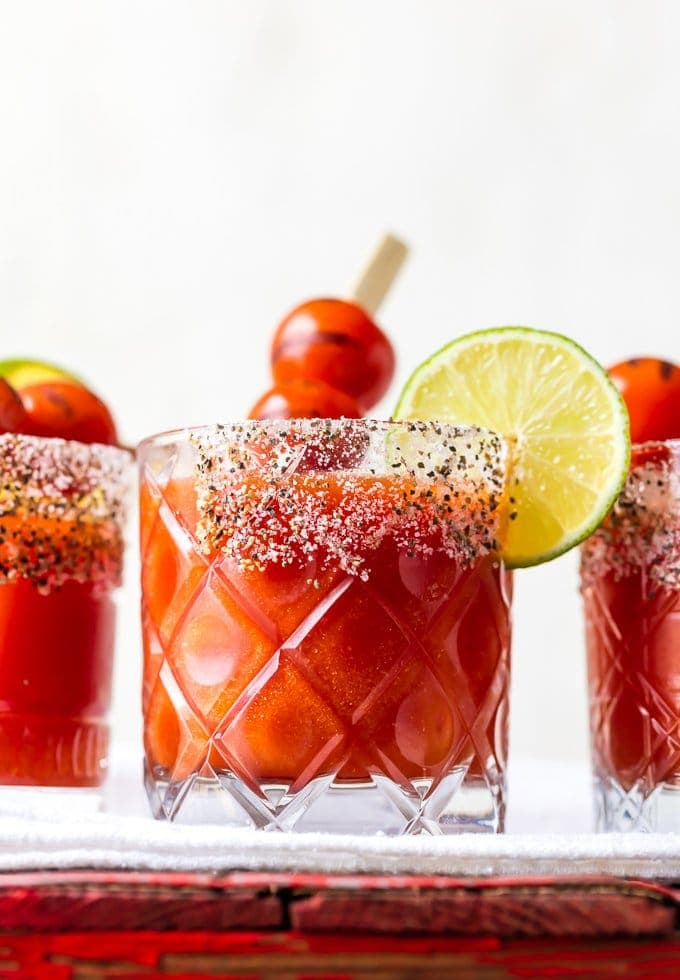 Roasted Tomato Margaritas in short glasses with salted rim