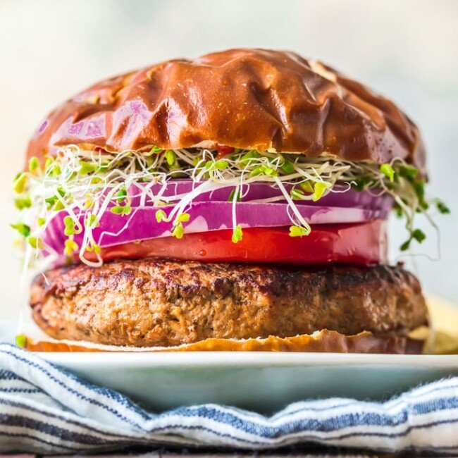 This is the BEST Turkey Burger Recipe. Turkey Burgers are a delicious and healthy burger option to replace ground beef. They're super juicy and flavorful, and they're easy to cook up on the stove. Try this turkey burger recipe instead of the usual beef burgers. You'll be surprised by how tasty they are!