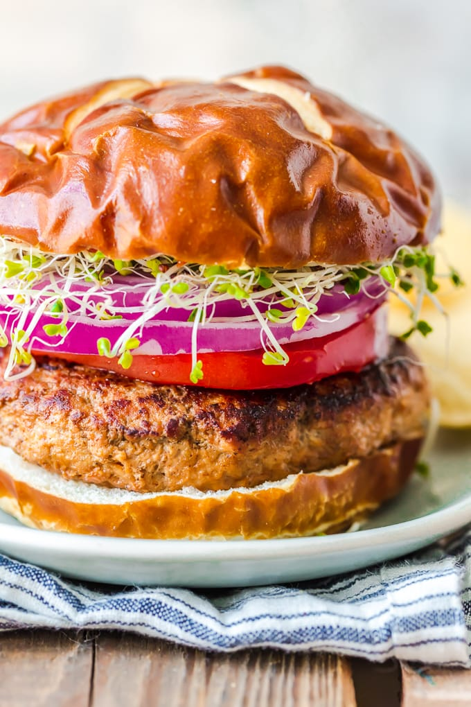 Turkey Burgers topped with onion, tomato, and greens