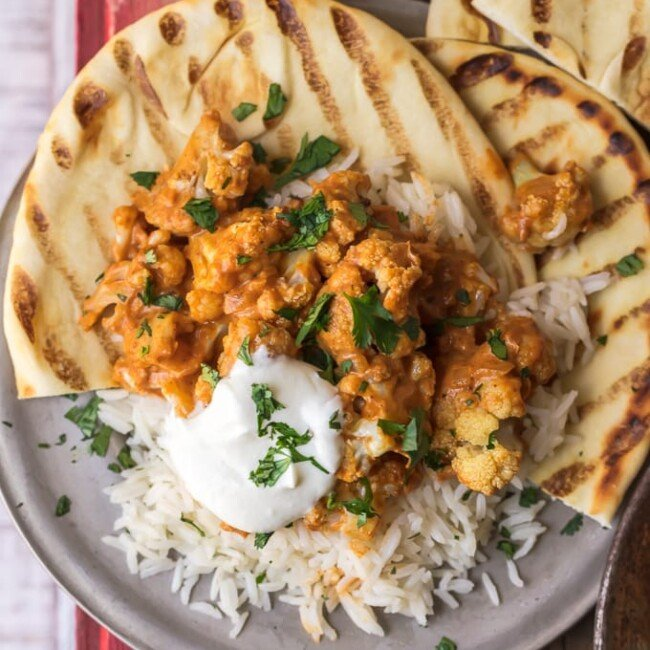 This vegetarian tikka masala recipe is made with cauliflower (Gobi Masala), served with basmati rice & naan. Roasted cauliflower mixed with tomato-based curry & plenty of spices!