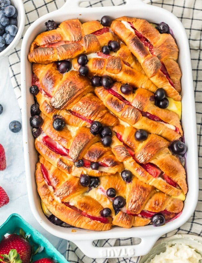croissant french toast casserole in a white dish