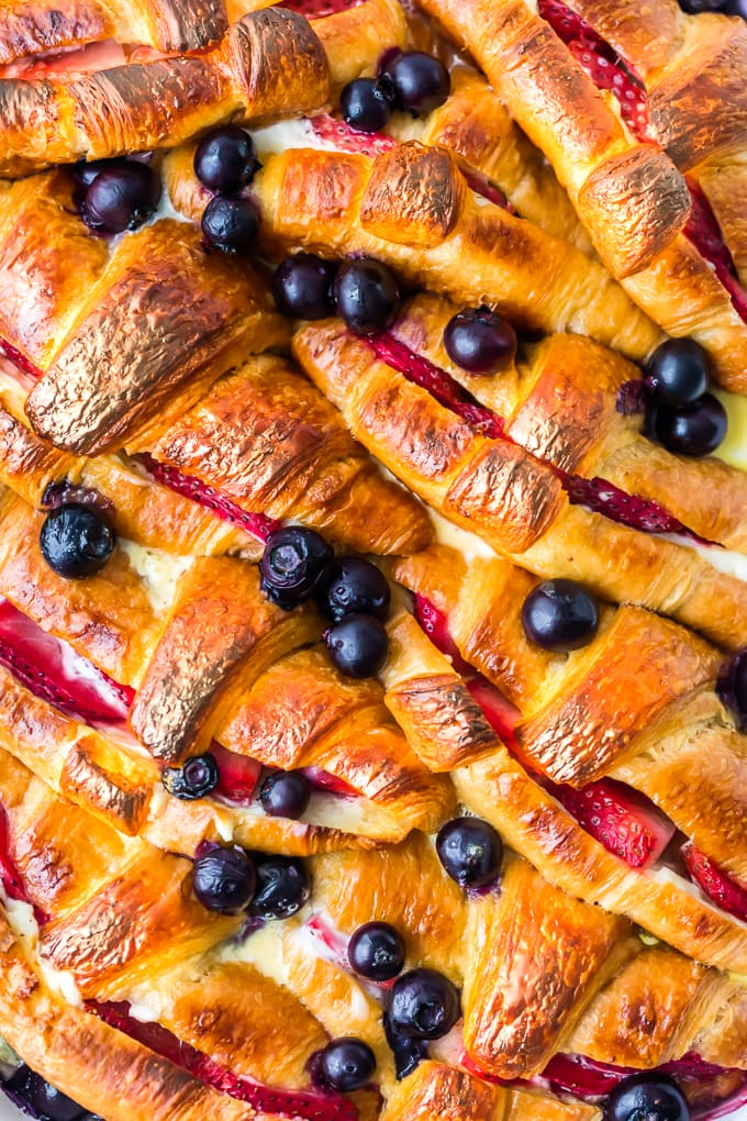 croissants, blueberries, and strawberries in a casserole dish