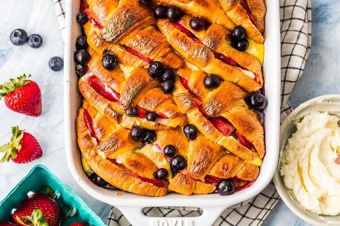 Croissant French Toast Casserole with Berries and Cream is our favorite easy brunch recipe fit for your closest friends and family. This indulgent breakfast French Toast Bake is made with layers of buttery croissants, sugary cream cheese, and fresh berries. You can make it ahead or right before you're ready to eat. Baked French Toast Casserole with Strawberries and Blueberries is the ultimate way to wake up!