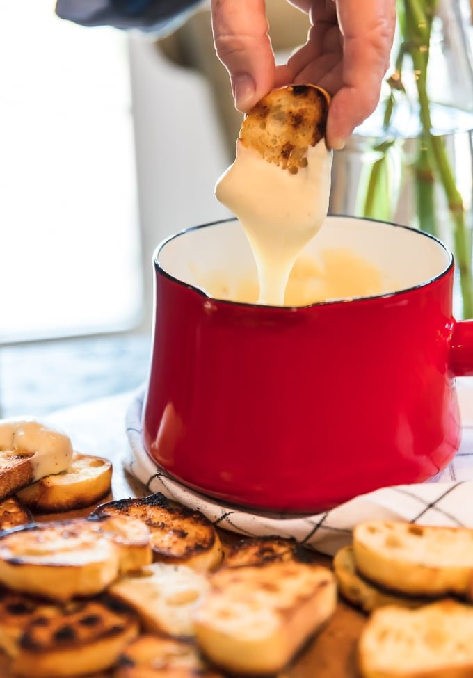 toasted sliced french bread dipped in cheese fondue