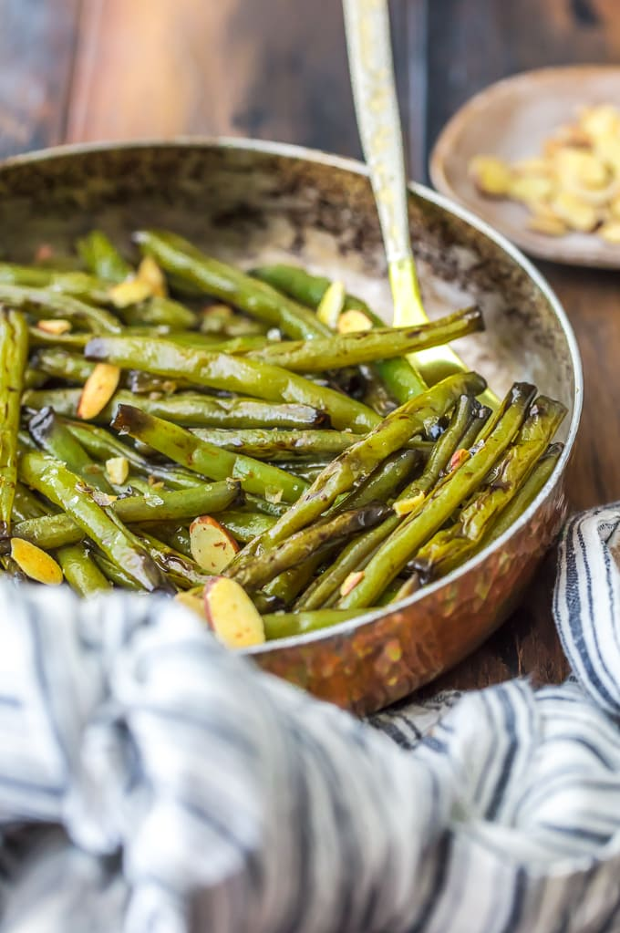 Sauteed green beans in a skillet, on a wooden table