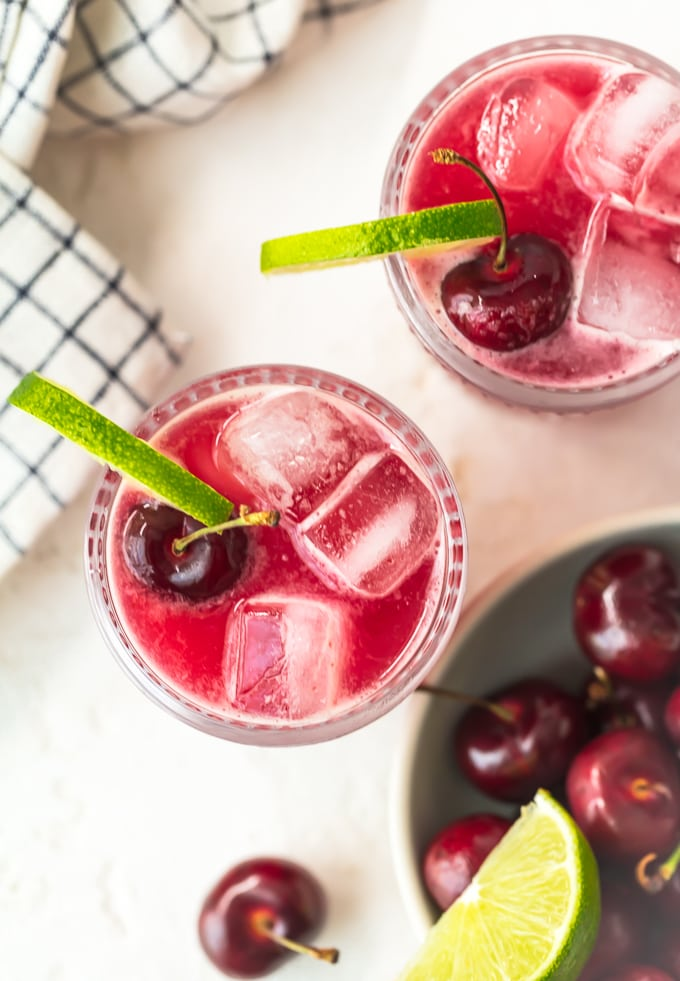 Refreshing cherry limeade recipe garnished with cherries and limes