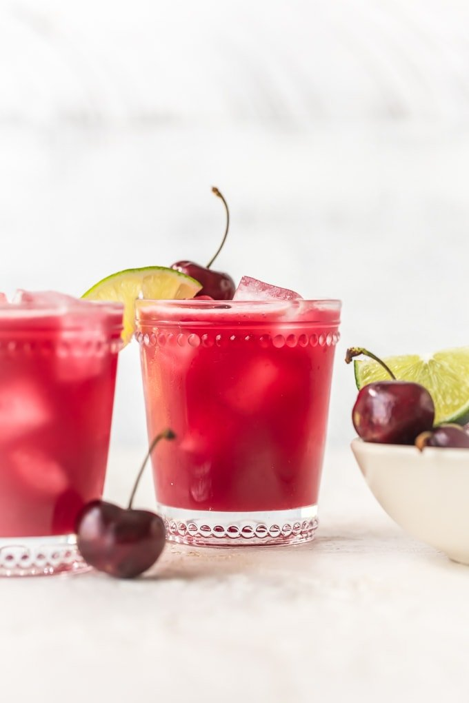 This homemade cherry limeade recipe is filled with fresh cherries & limes. One of the most refreshing summer drinks, with or without alcohol!